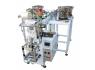 自動包裝機可運用機械臂對預制構件袋開展取袋、開袋、填裝